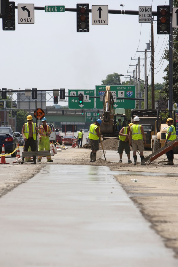 Concrete is put down near the intersection of Main Street and Lincoln Street on Tuesday in Bangor.