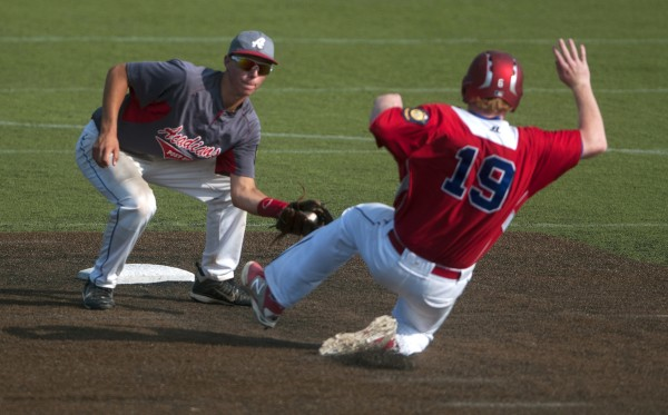 Trenton's Tony Bianco, left, tags out Motor City's Jackson Coutts at second during their Zone 1 American Legion baseball playoff game at Husson University in Bangor.