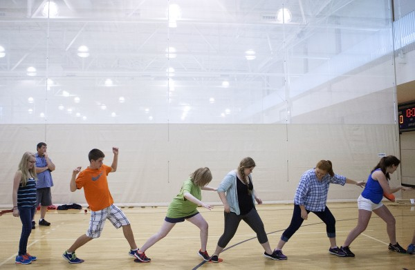 Medomak Valley students try to make it across the gym floor during a team building exercise as part of the Bridge Year program Wednesday at the Recreation and Fitness Center at the University of Maine.
