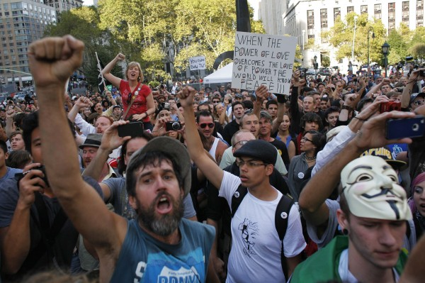 Occupy Wall Street protesters take part in activities organized by the movement at Foley Square, Lower Manhattan in New York, September 16, 2012.