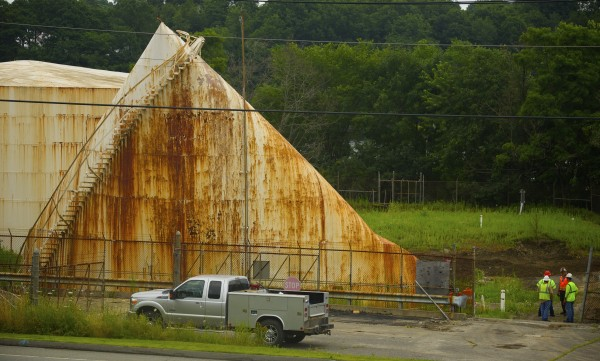 Unused oil tanks were being removed from a site on Main Road in Hampden on Tuesday.
