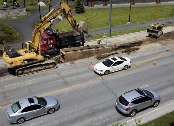 Cars pass construction near the intersection of Main Street and Buck Street on Tuesday in Bangor.
