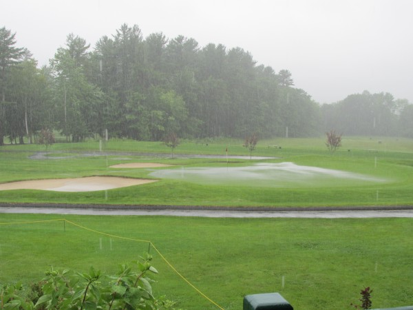 The 18th green at Waterville Country Club in Oakland was covered in standing water on Monday afternoon.