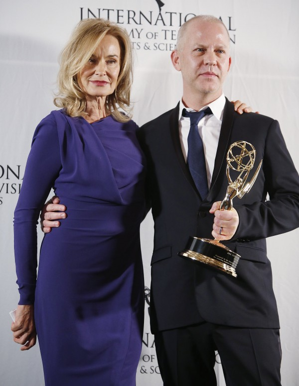 Actress Jessica Lange poses with producer Ryan Murphy as he holds his International Founders Award at the International Emmy Awards in New York in this November 2012 file photo.
