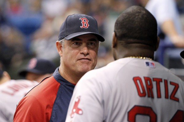 Boston Red Sox manager John Farrell (left) talks with designated hitter David Ortiz in the dugout at Tropicana Field in this May 2014 file photo.