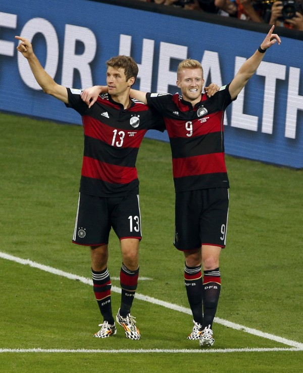 Germany's Andre Schuerrle and Thomas Mueller (left) celebrate after Schuerrle scored his second goal, the team's seventh, against Brazil during their 2014 World Cup semifinal at the Mineirao stadium in Belo Horizonte, Brazil, Tuesday.
