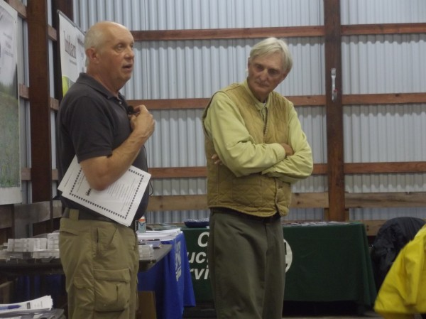 David Yarborough (left), blueberry specialist for the University of Maine Cooperative Extension, addresses growers at annual summer field day and meeting. Also shown is Frank Drummond (right), a University of Maine professor of insect ecology and entomology specialist, who briefed growers on how to assess pollination.