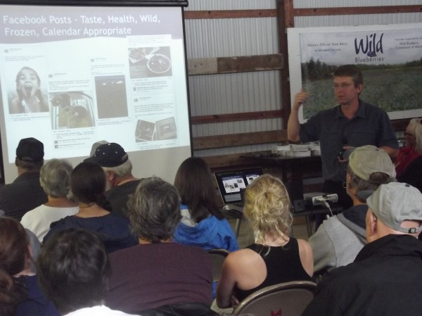 Michael Collins, senior marketing strategist for Westbrook-based Ethos Marketing and Design, discusses marketing campaign for the Wild Blueberry Association of North America during annual summer field day and meeting for blueberry growers.