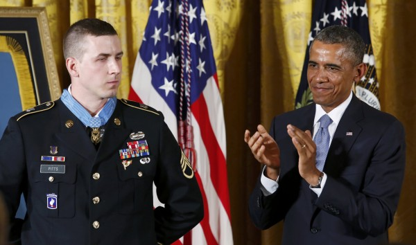 President Barack Obama applauds former U.S. Army Staff Sgt. Ryan M. Pitts after awarding Pitts the Medal of Honor for gallantry in Afghanistan.