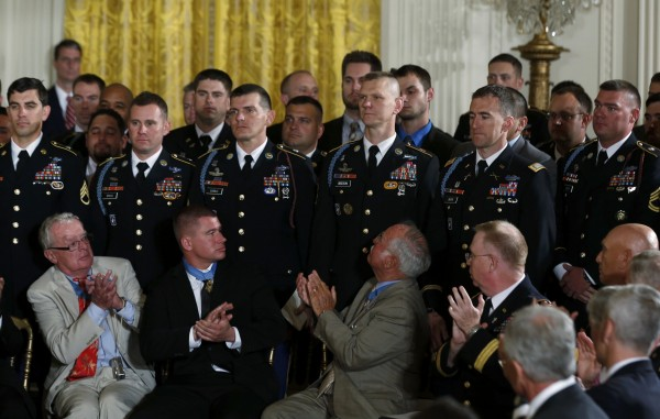 Previous Medal of Honor recipients, bottom, applaud members of former U.S. Army Staff Sgt. Ryan Pitts' unit 2nd Platoon, Chosen Company, 2nd Battalion (Airborne), 503rd Infantry Regiment, 173rd Airborn Brigade, top, during a White House ceremony.