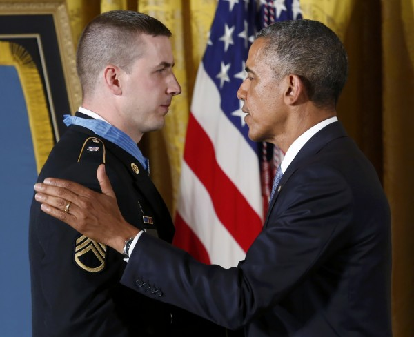 President Barack Obama congratulates former U.S. Army Staff Sgt. Ryan M. Pitts after awarding Pitts the Medal of Honor for gallantry in Afghanistan.