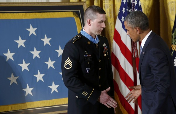 President Barack Obama congratulates former U.S. Army Staff Sgt. Ryan M. Pitts after awarding Pitts the Medal of Honor.