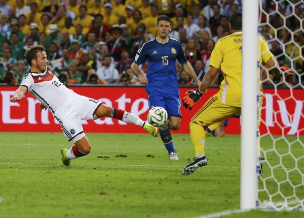 Germany's Mario Goetze shoots to score a goal past Argentina goalkeeper Sergio Romero during overtime in their 2014 World Cup final at the Maracana stadium in Rio de Janeiro July 13, 2014.