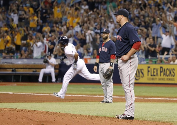 Boston Red Sox starting pitcher Jon Lester (31) reacts as Tampa Bay's Desmond Jennings (8) runs around the bases after hitting a two-run home run during the fifth inning at Tropicana Field in St. Petersburg, Fla., Friday night.