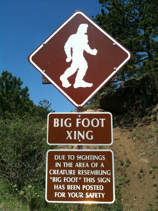 In this July 2011 file photo, a sign on Pikes Peak highway in Chipita Park, Colorado, mentions sightings of Bigfoot.