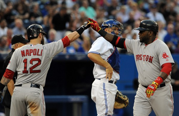 Boston Red Sox designated hitter David Ortiz is greeted at home plate by Mike Napoli after hitting a two-run home run against Toronto Blue Jays in the fourth inning Monday night in Toronto.