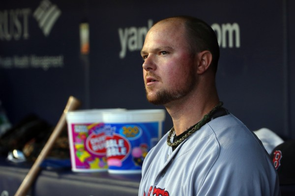Boston Red Sox starting pitcher Jon Lester in the dugout during the third inning against the New York Yankees at Yankee Stadium in this June 2014 file photo.