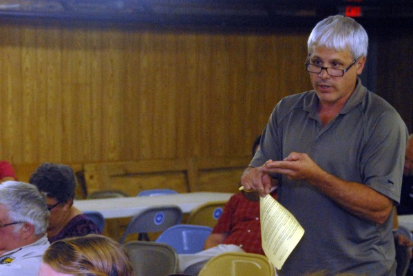 Lincoln resident Byron Sanderson speaks to the Lincoln Town Council during a meeting at the town office Monday, July 14, 2014.