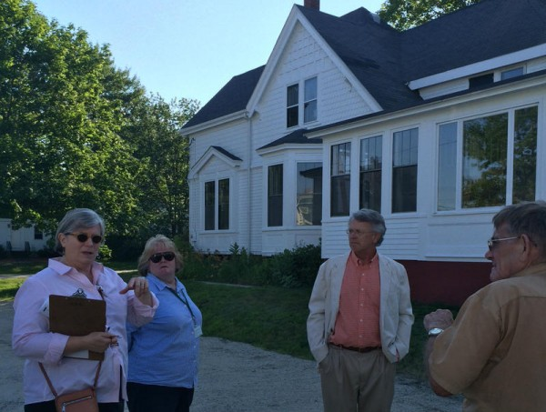 Architects Mac Collins, third from left, and Nancy Barba, left, led a July 9 site walk at the L.L. Bean home in Freeport.