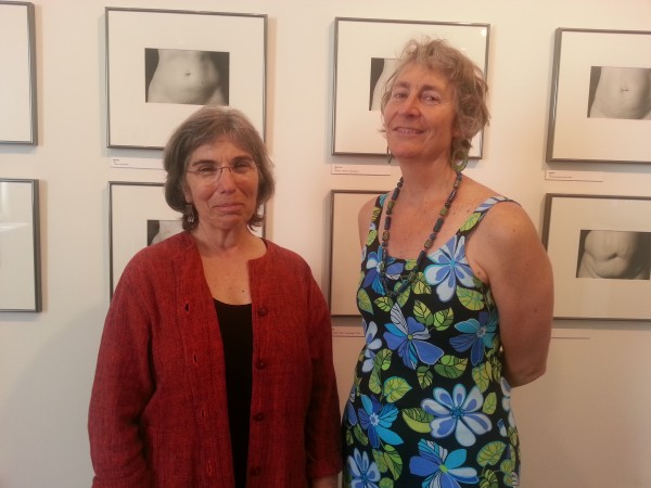 Lisa Kushner (left) and Martha Piscuskas, the co-director of Waterfall Arts, talk about &quotThe Belly Project,&quot part of the summer's &quotLiving in These Bodies Part 1&quot art exhibit.