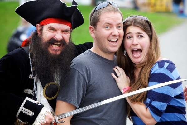 Alison and Kevin Klucher of Maryland enjoy a menacing photo op with Blackbeard the Pirate, played by Al Simmons of Friendship, at the 67th annual Maine Lobster Festival in Rockland on Wednesday. It's Simmons' first year in the role, though he shadowed the previous scurvy dog for two seasons.