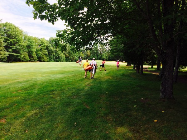 The first group of players made up of Emily Bouchard, Debby Gardner and Kris Kannegieser walk down the right-hand side of the 14th fairway in preparation for their respective second shots during Tuesday's Maine Women's Amateur golf championship at Waterville Country Club in Oakland.