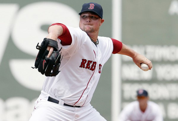 Boston Red Sox starting pitcher Jon Lester throws a pitch against the Kansas City Royals in the first inning at Fenway Park in Boston on Sunday.