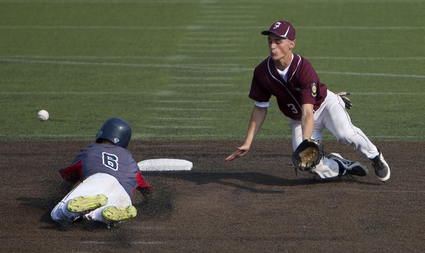 Trenton's Jon Phelps (left) safely steals second base past Brewer's Chase Allen during a Zone 1 American Legion playoff game Wednesday at Husson University.