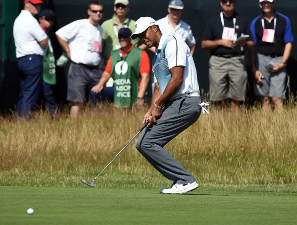 Tiger Woods reacts after missing a putt on the 8th green during his first round at The 143rd Open Championship at the Royal Liverpool Golf Club in Hoylake, England, Thursday.