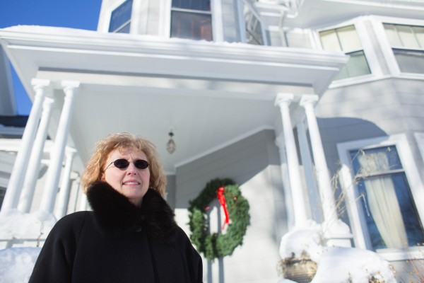 Pauline Civiello stands in front of her house in downtown Bangor.