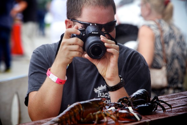 Kevin Klucher of Maryland snaps a photo of a live lobster in Rockland on Wednesday at the 67th annual Maine Lobster Festival.