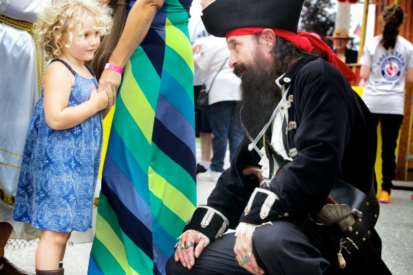 Blackbeard the Pirate tries to make friends with Julia Staples, 3, of Appleton on Wednesday at the Maine Lobster Festival in Rockland. Blackbeard is also known as Al Simmons of Friendship.