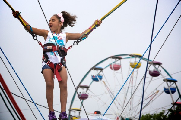 Madison Lempke, 6, goes sky-high at the 67th annual Maine Lobster Festival in Rockland on Wednesday.