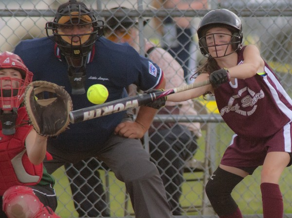 Ellsworth's Trinity Montigny lays down a bunt in the fourth inning of against Shaker Valley during the Little League state softball tourney in Hermon on Monday,