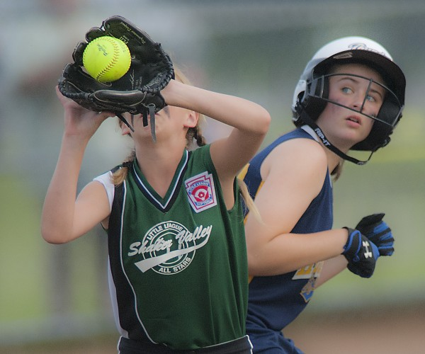 Hermon base runner Megan Chamberlain watches the ball as Shaker Valley second baseman Catelyn McGrath collects a throw at second base from the outfield in the fifth inning of their game at the Little League state softball tourney for ages 11-12 in Hermon on Tuesday.