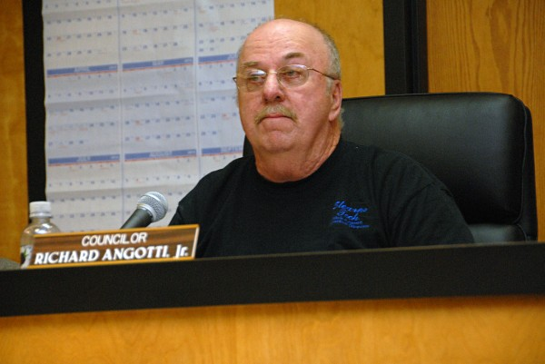 Millinocket Town Council Chairman Richard Angotti Jr. listens to residents during a council meeting on Feb. 27, 2014.