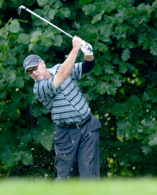 John Hickson of Topsham follows through on his tee shot on the par 3 15th hole at the Augusta Country Club Monday morning during the opening round of the 2014 Charlies Maine Open that was eventually washed out.
