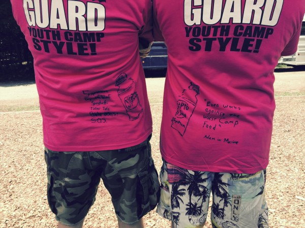Two adult volunteers at the Maine National Guard youth camp in Gilead took advantage of the color of the T-shirts this year to make reference to Pepto-Bismol as a joke. &quotHe completes me,&quot one said, drawing laughter from the junior campers around them. Campers were informed to call the color &quotsangria&quot or &quotsalmon&quot and were given push ups for saying the word &quotpink.&quot