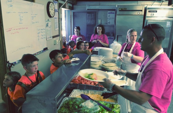 Youth camper go through the mess hall at the Maine National Guard youth camp in Gilead. The summer camp for military children is in its 15th year and brings kids of from all branches of the military together for camaraderie.
