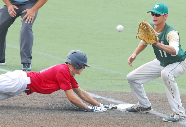 Devin Warren of Oakland Post 51 slides back to first, ahead of the tag from Bessey Motors first baseman Dalton Rice in first-inning action at the American Legion baseball state tourney Wednesday at Husson University's Winkin Complex in Bangor.