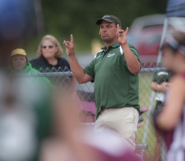Shaker Valley coach Kevin Tutt signals his players with two outs in the fourth inning of their game against Ellsworth in Hermon on Monday.