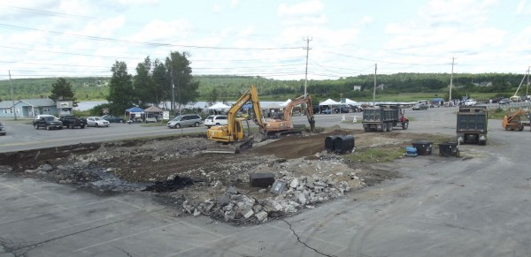 Excavators work recently to prepare the building site where Helen's Restaurant used to stand.