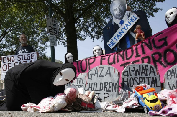 Codepink activists, dressed to symbolize those wounded and killed in Gaza, rally outside the Israeli Embassy in Washington on Wednesday.