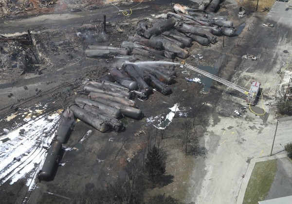 An aerial view of burnt train cars after a train derailment and explosion in Lac-Megantic, Quebec July 8, 2013.