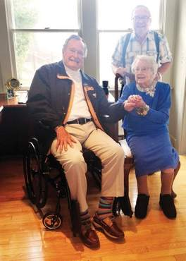 Millie Rennie, who at 105 has been recognized as Maine's oldest resident, meets former President George H.W. Bush, a longtime wish, at his family compound on Walker's Point in Kennebunkport Tuesday.