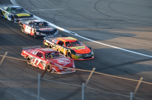 Travis Benjamin of Morrill (17) races alongside Cassius Clark (77) of Farmington in the early stages of the TD Bank 250 on July 21, 2013, at Oxford Plains Speedway