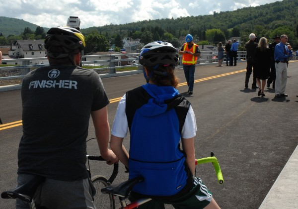A pair of cyclists get ready to be the first to ride across the newly opened international bridge connecting Fort Kent to New Brunswick Thursday morning.