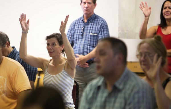 Esther Attean (center) waves her hands to signal her approval of one resident's opinion about a controversial plan to build a landfill and recycling facility in Argyle Township or Greenbush.