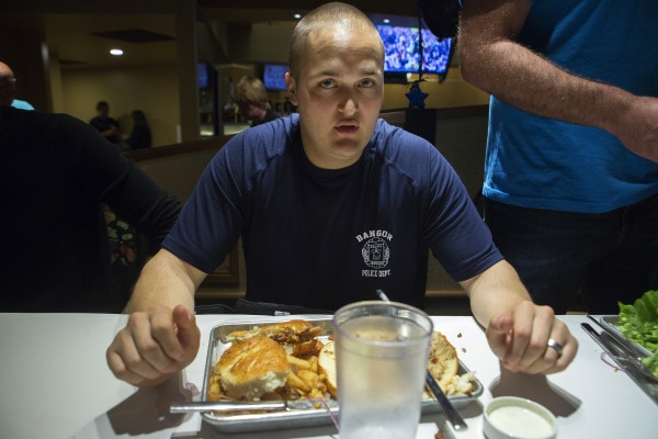 Bangor police Officer Jose Vidaurri takes a break during a burger-eating contest Tuesday at the Celebrity Bar & Grill in Hollywood Casino in Bangor.