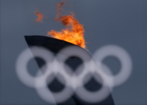 The Olympic flame is reflected in the window at the Olympics Park during the Sochi 2014 Winter Olympics Games in February 2014.